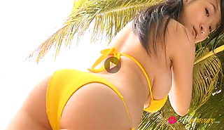 Rui Kiriyama steamy Japanese babe in yellow tiny bikini